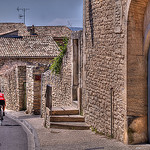 Cyclist in Gordes par C.R. Courson - Gordes 84220 Vaucluse Provence France