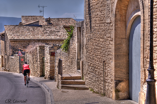 Cyclist in Gordes by C.R. Courson