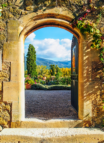 An Open Doorway of the Château de Lourmarin by philhaber